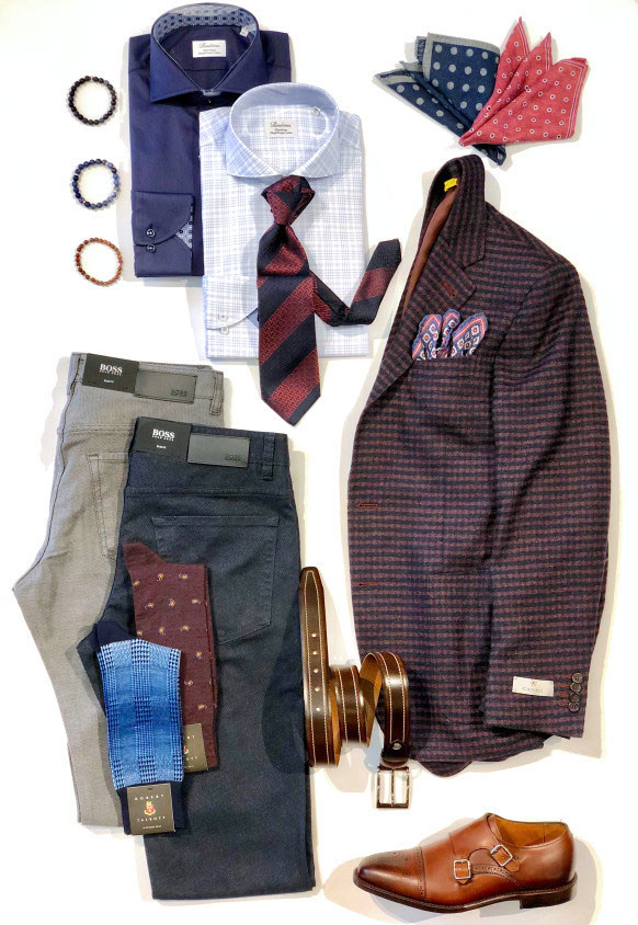 Laydown of the perfect holiday outfit including blazer, pants, shirts and accessories